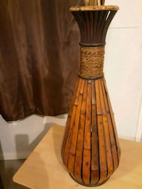 brown and black wooden stick or flowers holder 651 mi