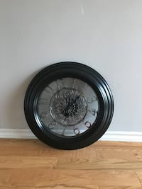 Black and silver clock like nw 779 km
