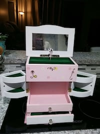 white and pink jewelry box musical