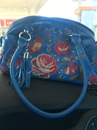 blue and multicolored floral backpack 280 mi