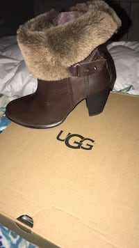 pair of brown leather boots 2334 mi