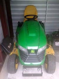 green and yellow ride on lawn mower Germantown