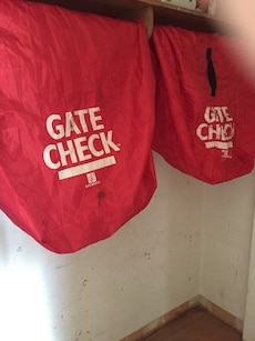 white-and-red Gate Check bags