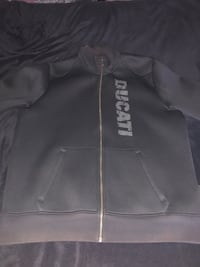 Black Ducati zip-up jacket by puma. Slight discoloring on sleeve cuff, also on the collar and bottom. Other than that this jacket is in 8/10 condition. Size large  Chantilly, 20152