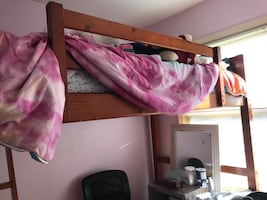 Twin size loft bed with latter