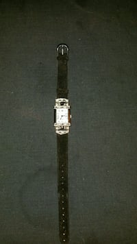 rectangular silver-colored analog watch with black leather strap