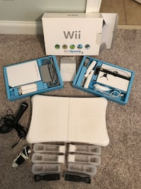 WII Console with multiple accessories and games. Includes balance board, 4 controllers, 2 numchuks, and microphone Kannapolis, 28081