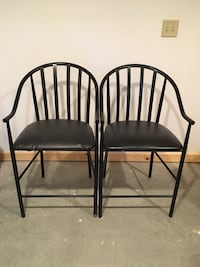 """two padded black metal-framed armchairs sits at 24"""" and back is 38.5"""" in height. Can be reupholstered easily. Cooke, 17241"""