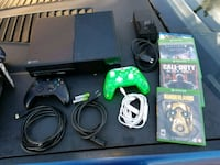 Xbox One console with controller and game cases Los Angeles, 91331