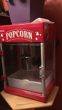 red and gray West Bend popcorn machine
