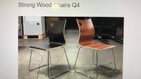 two brown wooden chairs with brown leather pads