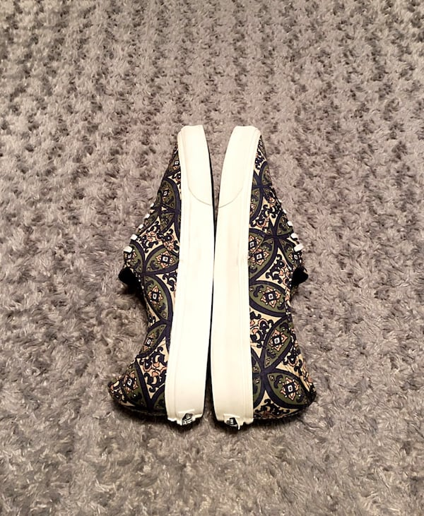 Vans lo-top paid $65 size 13 printed design. Excellent condition has no signs of wear.  4046a0d2-7f88-4536-a051-0497ab577ff9