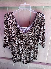 Women's maternity leopard top size XL. Great condition. Serious buyers only. First come first serve. No holds. Pickup in orange. Check out my other offers thanks! Orange, 92867