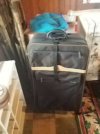 black and white luggage bag