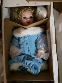 porcelain doll wearing blue dress Edmonton, T5M 0L1