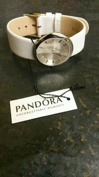 round silver analog watch with silver link bracelet Bolton