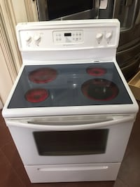 White and black induction range oven Brampton
