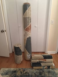 Brand new 5x7 area rug and matching runner and accent rugs!