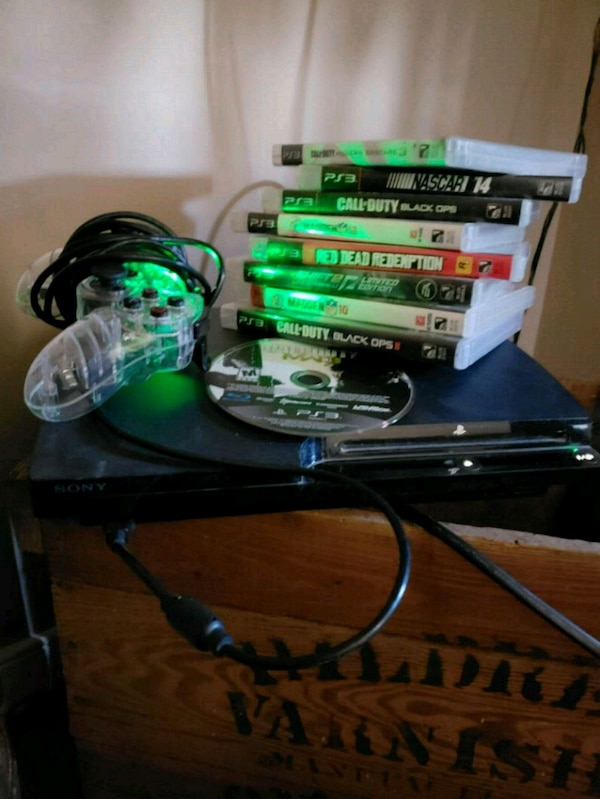 black Xbox 360 console with game cases