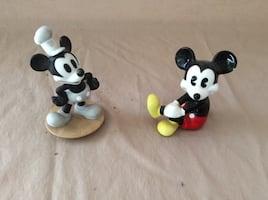 Two Mickey Mouse figurines.