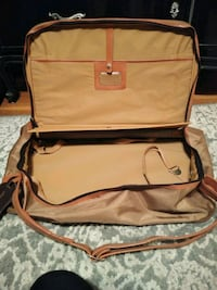 brown and black leather handbag St. Louis, 63125