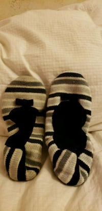 pair of black-and-white knitted socks 76 mi