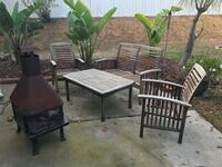"""Teak outdoor furniture and fire pit. Fire pit has rust and does not need to be included if not wanted. Table: 43"""" wide, 23"""" deep, 19"""" tall. 2 chairs: 23"""" wide, 24"""" deep and 35"""" tall. Loveseat: 24"""" deep, 35"""" tall, 48"""" wide."""
