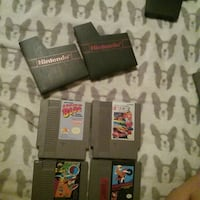 four assorted-title NES game cartridges Macon, 31211