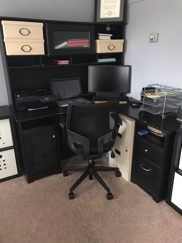 Black wooden computer desk with hutch