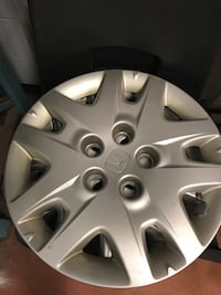 """16"""" Honda Odyssey wheel covers with wheel nuts."""