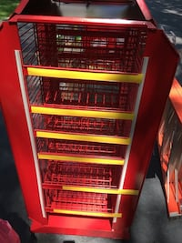 Brand new. Never used. On wheel mobility. Red and black metal rack.