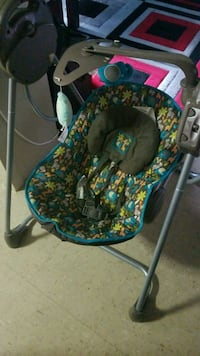 baby's blue and green swing chair
