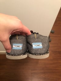 Pair of gray toms classic slip-on shoes Waltham, 02453