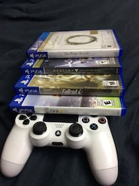 white Sony PS4 game console with controllers and game cases Coquitlam, V3B 6E3