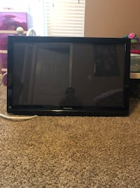black flat screen TV with remote Lithonia, 30058