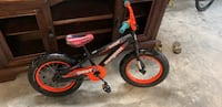toddler's black and red bicycle P C BEACH, 32408