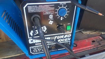 Blue and black portable welding machine