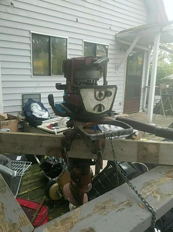 black and gray outboard motor