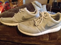 pair of grey Nike Rosche run shoes