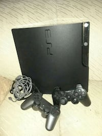 black Sony PS3 slim console with two controllers Las Vegas, 89119