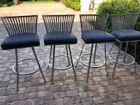 four black metal framed black padded chairs Venice, 34293