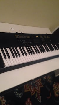 Black electronic keyboard. ACCEPT TRADES AND CASH