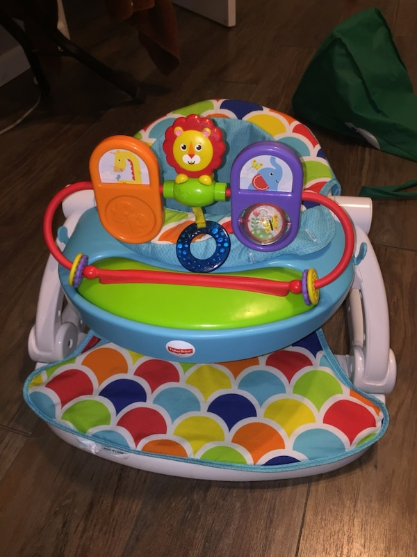 baby's multi-colored Fisher-Price Smart Stage floor seat
