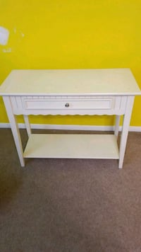 white wooden 2-drawer console table