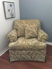 Brown and green floral sofa chair.  North Port, 34291