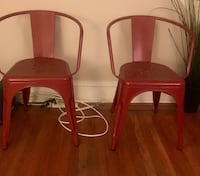 2 red metal chairs