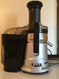 Grey and black Oster juice extractor Vancouver, V6E 1J1