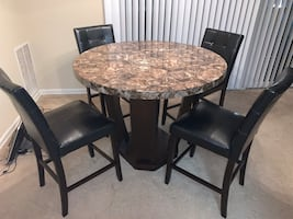 Two sofas/recliners and dining room table with 4 chairs