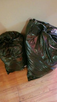 Two garbage bags full of womans clothing