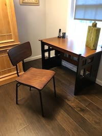 Desk from Pier one with wood chair by Magnolia Homes Pepperell, 01463